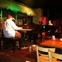 Photo taken at Rum Runners by Kristi G. on 9/9/2012