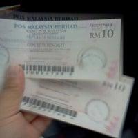 Photo taken at Pejabat Pos (Post Office) by Pria M. on 3/12/2012