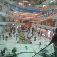 Photo taken at Ambience Mall by Arkid M. on 1/26/2012