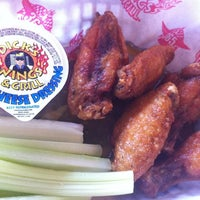 Photo taken at Dick's Wings & Grill by Michael M. on 4/20/2012