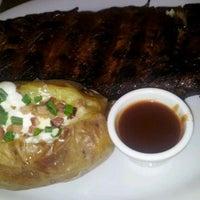 Photo taken at Capital Steakhouse by Ronaldo P. on 3/17/2012