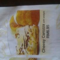 Photo taken at Upperstar Steak & Chicken Restaurant by Carrie B. on 10/2/2011
