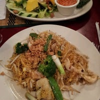 Photo taken at Thai Basil Restaurant by Vitor D. on 11/6/2011