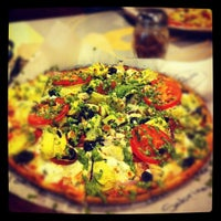 Photo taken at Pieology Pizzeria by Sabrina R. on 3/26/2012