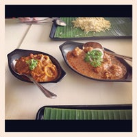 Photo taken at Muthu's Curry Restaurant by Monrawee W. on 7/20/2012