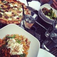 Photo taken at Muddy Waters Bar & Eatery by Natasha P. on 6/16/2012