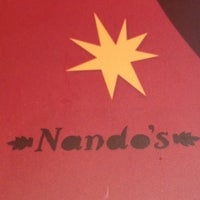 Photo taken at Nando's by Niko on 12/23/2011