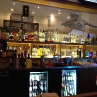 Photo taken at The Over/Under Bar & Grill by Dustin B. on 7/22/2012