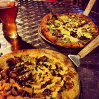 Photo taken at Mellow Mushroom by Monica on 6/14/2012