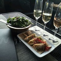 Photo taken at Willi's Wine Bar by Jose D. on 4/7/2012