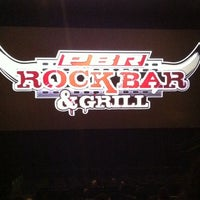 Photo taken at PBR Rock Bar & Grill by JOelo P. on 3/7/2012