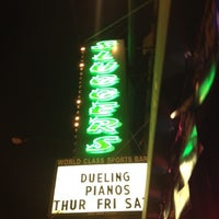 Photo taken at Sluggers World Class Sports Bar and Grill by Nathan V. on 6/9/2012