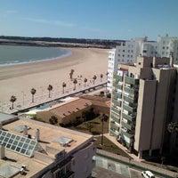 Photo taken at Playa de Valdelagrana by Sergio V. on 4/16/2012