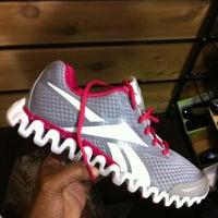 Photo taken at DSW Designer Shoe Warehouse by Paris J. on 3/1/2012