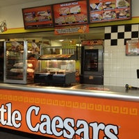 Photo taken at Little Caesars Pizza by Michael K. on 8/25/2012