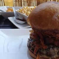 Photo taken at Umami Burger by Eddie G. on 7/14/2012