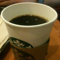 Photo taken at Starbucks Coffee by Ellen V. on 3/19/2012