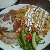 Photo taken at Mi Cocina by Dennis D. on 7/26/2012