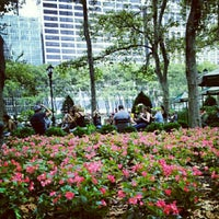 Photo taken at Southwest Porch at Bryant Park by Bryan V. on 7/27/2012