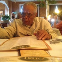 Photo taken at Brio Tuscan Grille by Julian K. on 6/8/2012