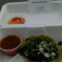 Photo taken at El Mercado Taco Wagon by Colorado Card on 2/6/2012