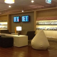 Photo taken at Louis' Tavern CIP Lounge by DW K. on 5/30/2012