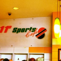 Photo taken at 11• Sports Cafe by Faridah D. on 7/7/2012