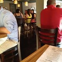 Photo taken at SOHO Kitchen & Bar by Michael D. on 7/13/2012