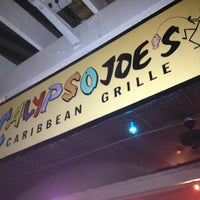 Photo taken at Calypso Joe's Caribbean Grille by Melissa D. on 8/18/2012