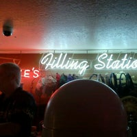 Photo taken at Charlie's Filling Station Lounge by Dan R. on 3/18/2012