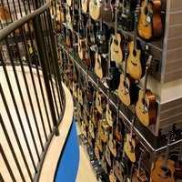 Photo taken at Cosmo Music - The Musical Instrument Superstore! by Christopher B. on 2/13/2012