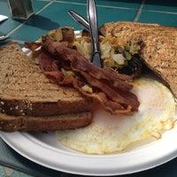 Photo taken at Kono's Surf Club Cafe by Jeff L. on 2/26/2012