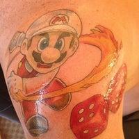 Photo taken at Tattoo Cafe by Jen G. on 6/17/2012