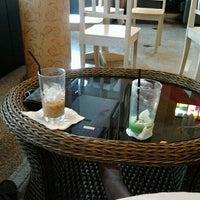 Photo taken at ESCAPE Bistro & Café by Khawtaan K. on 6/25/2012