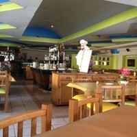 Photo taken at Churrascaria Samba Grill by Julio G. on 7/29/2012