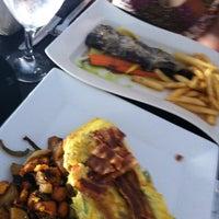 Photo taken at Altus Cafe by Jay C. on 5/20/2012
