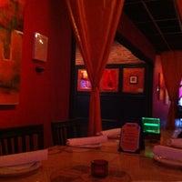 Photo taken at Babaloo International Cafe and Bar by Paula C. on 6/10/2012
