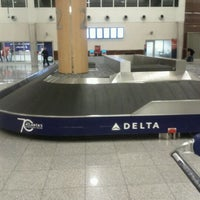 Photo taken at South Baggage Claim by marcus t. on 2/9/2012