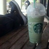 Photo taken at Starbucks by Mitsu M. on 6/10/2012