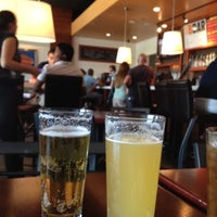 Photo taken at Village Burger Bar by Laura H. on 8/5/2012