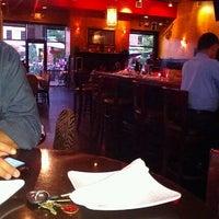 Photo taken at Babaloo International Cafe and Bar by Gina C. on 7/20/2012