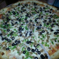 Photo taken at Elidios' Pizza by Todd-Rachel M. on 7/6/2012