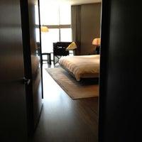 Photo taken at Armani Hotel Dubai by Ali A. on 6/18/2012