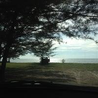 Photo taken at Layang-layangan Beach by Cintami A. on 5/30/2012