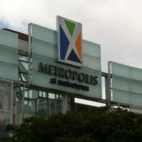 Photo taken at Metropolis at Metrotown by Fabio R. on 6/24/2012