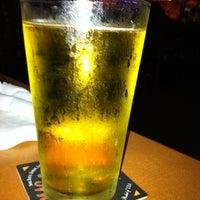 Photo taken at Boston's Restaurant & Sports Bar by Landon S. on 6/30/2012