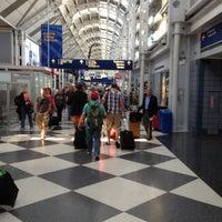 Photo taken at Terminal 1 by Juliana M. on 6/22/2012