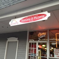 Photo taken at John's Pizzeria & Restaurant by Megan M. on 8/10/2012