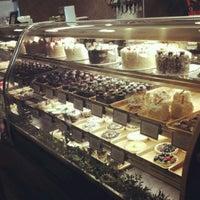 Photo taken at Truffles & Tortes Dessert Cafe by Heidi G. on 4/26/2012
