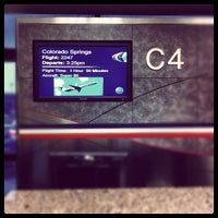 Photo taken at Gate C4 by Christopher W. on 3/10/2012